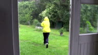 Shower of hail rain and woman run to outdoor toilet video