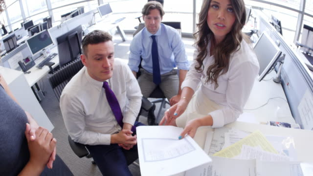 Showing document to business colleagues, POV shot video