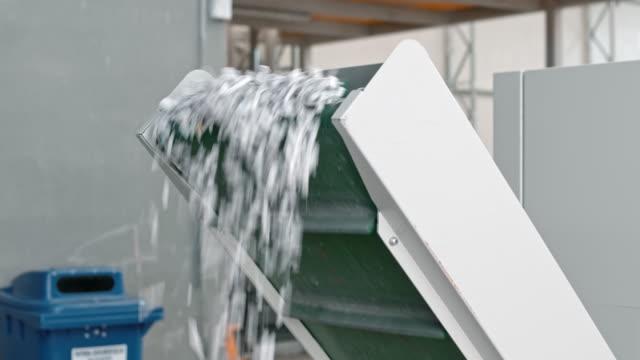 LD Shredded paper falling from conveyor belt of industrial shredder video