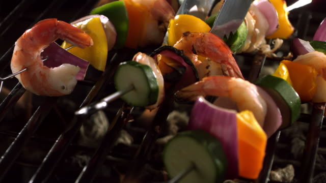 Shrimp and vegetable skewers on grill video