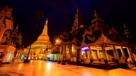 Shwedagon Pagoda Famous Landmark Golden Pagoda Place Night to Day Time Lapse Of Yangon City, Myanmar (zoom out) video