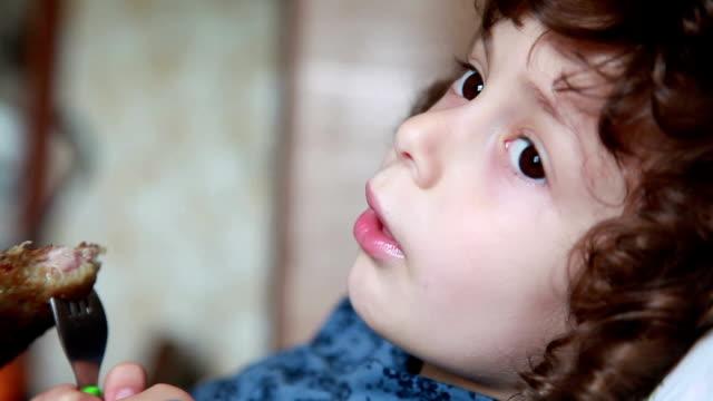 Shy little girl eating pancake video
