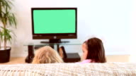 Siblings watching the television video