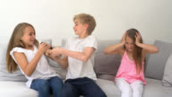 Siblings watching tv and fighting over the control remote video