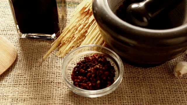 Sichouan pepper in small glass bowl and in mortar; video