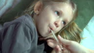 Sick Child Sneezes then her Mother Check Temperature with Thermometer video