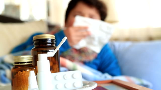 Sick child sneezing into tissue  Flu  Child caught cold video