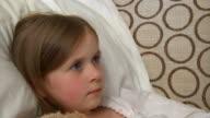 Sick child taking medicine video