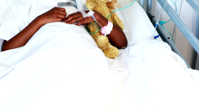 Sick girl in oxygen mask resting with teddy bear video