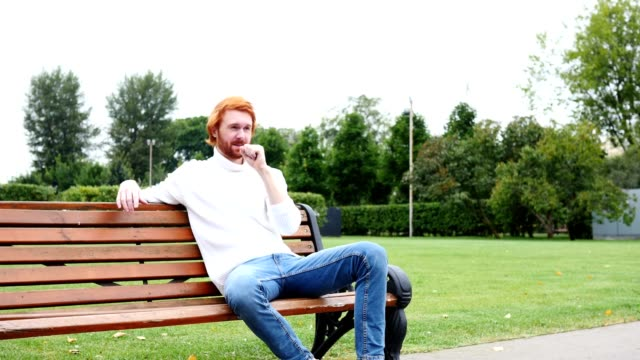 Sick Man Coughing, Sitting in Park, Red Hairs and Beard video