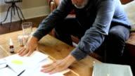 sick man pushes bills away video