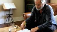 sick man worried by medical bills video