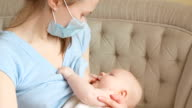 Sick mother breastfeeding her baby video