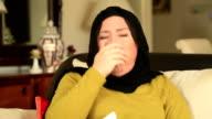 Sick muslim woman coughing video