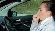 Sick woman coughing in the car video