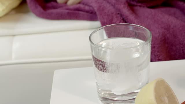 Sick Woman dissolving aspirine video
