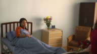 Sick woman hospitalized in private clinic with family and friends video