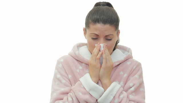 Sick woman in bathrobe coughing and blowing nose. video