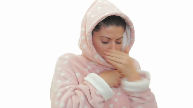 Sick woman in bathrobe coughing. video
