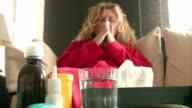 Sick woman sneezing video