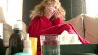 Sick women sneezing video