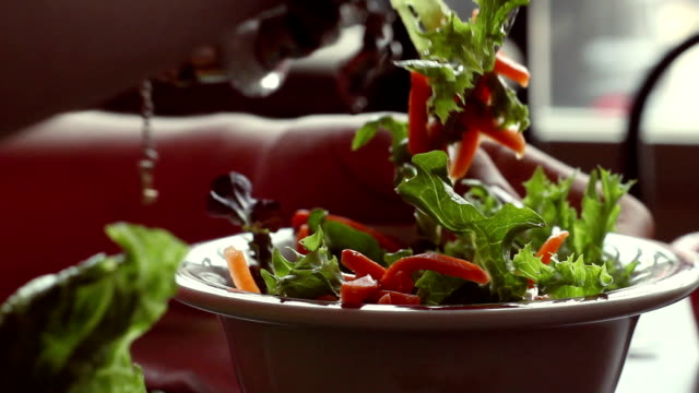 A Side Salad is eaten in restaurant in dramatic back lighting video
