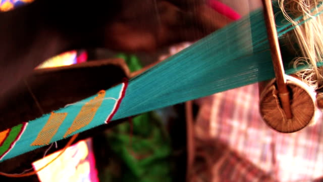 Side Shot of an African Man Weaving a Colorful Sash video