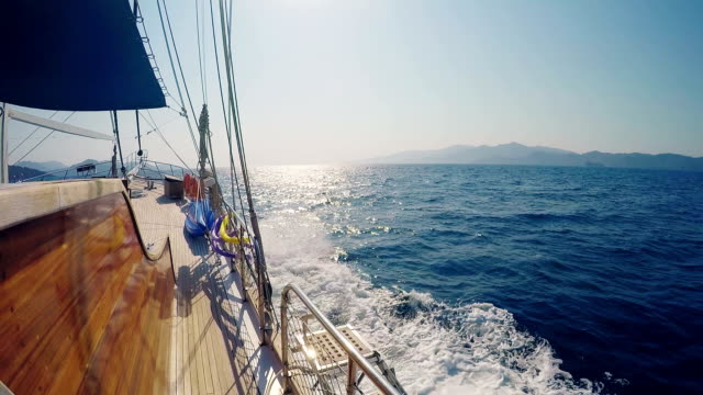 Side view from a yacht cruising mediterranean costs (boat point of view) video