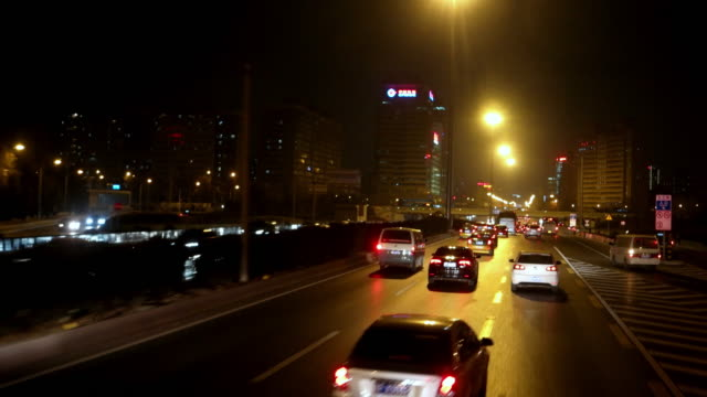 POV Side View of Night driving in Beijing, China video