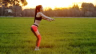 Side view of young woman doing squats outdoors video