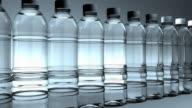 Side view, Water bottles slowly moving (Loop) video