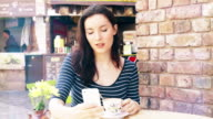 Sidewalk cafe, coffee and phone message. 2 of 5. video