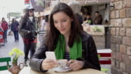 Sidewalk cafe, coffee and phone message. 4 of 4. video