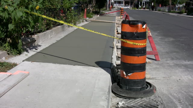 Sidewalk with wet cement. video