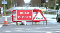 Sign Warning Of Road Closure Due To Flooding video