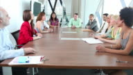 Signing contracts in boardroom video