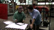 Signing Document in Factory video