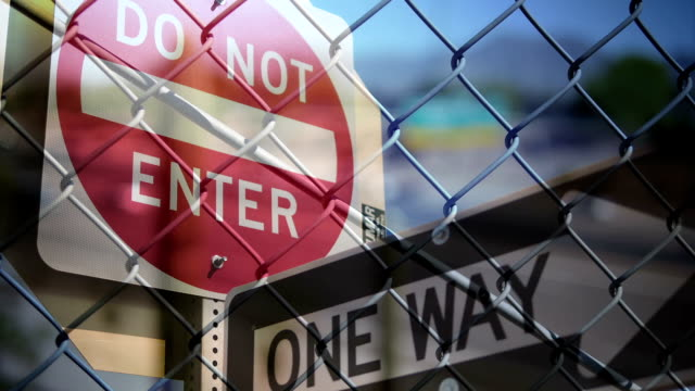 Signs, Chain Link Fence, and Traffic Overlay video