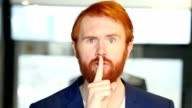 Silence by Businessman, Finger on Lips video