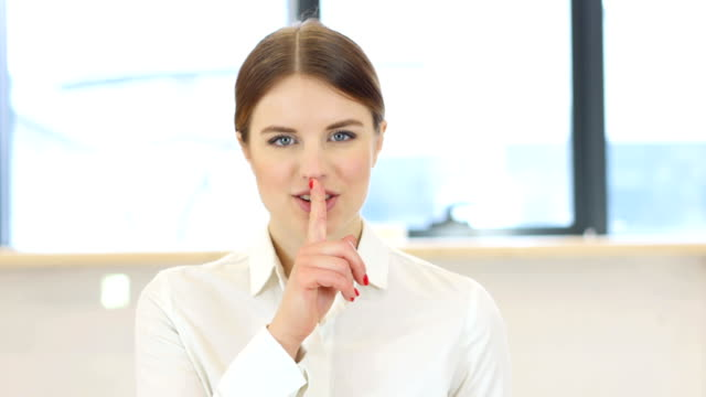Silence, Finger on Lips of Woman in Office video