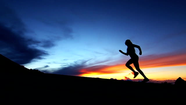 Silhouete Couple Running Up Hill An Sunset (Slow Motion) video