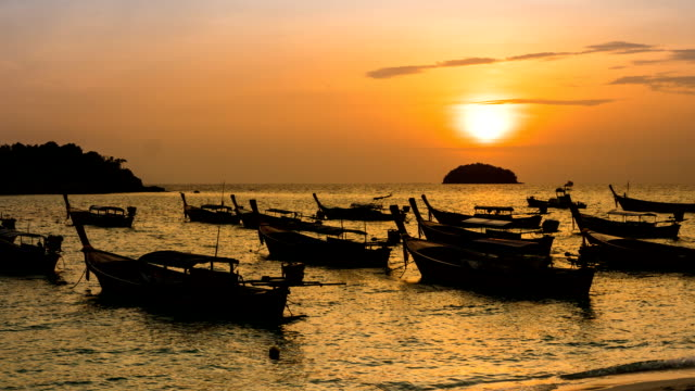 TL ZO silhouette boats over sea at Koh Lipe during sunrise, sun moviing up video