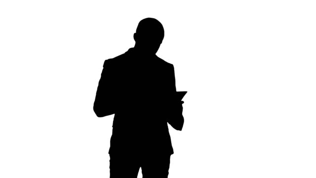 Silhouette Concentrated businessman reading financial report video