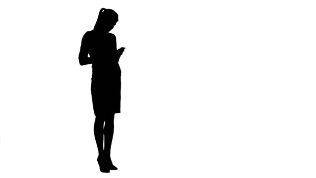 Silhouette Concentrated secretary sending phone text messages video