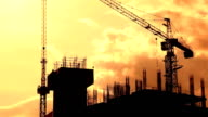 Silhouette Crane Working In Construction Site video