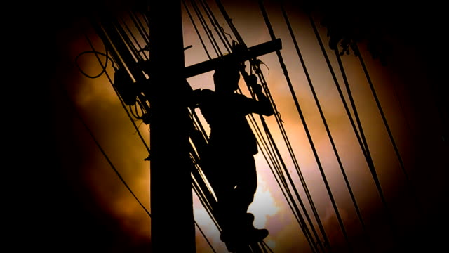 Silhouette Electrician wiring on Pole video