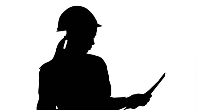 Silhouette Female engineer in helmet reading contract and nodding her head video