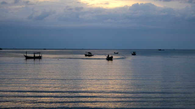 Silhouette fishing boat in the sea at morning, tranquil scene video