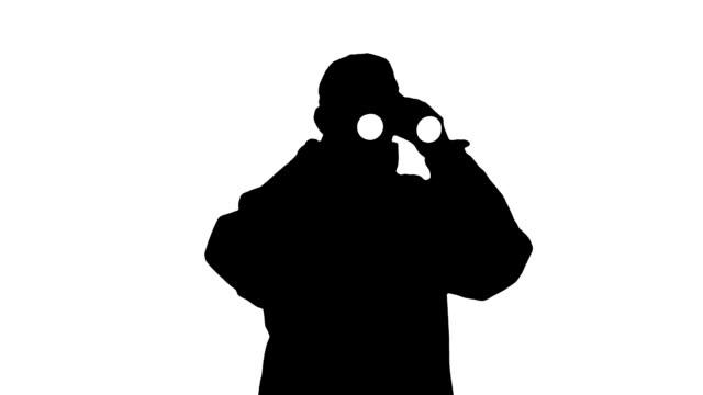 Silhouette Guard Looks Through Binoculars video