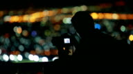 silhouette, night photo of photographer as take a photo video